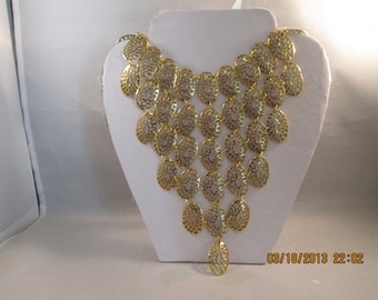 Bib Necklace with Gold Tone Filigree Bead Pendants on a Gold Tone Chain