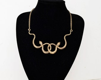 Necklace of two golden snakes
