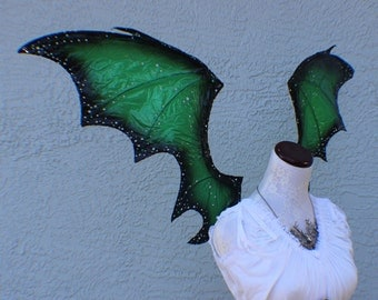 Dragon inspired wings in dark green and black with jewels