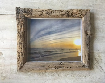 rustic driftwood frame weathered by sea sun and sand