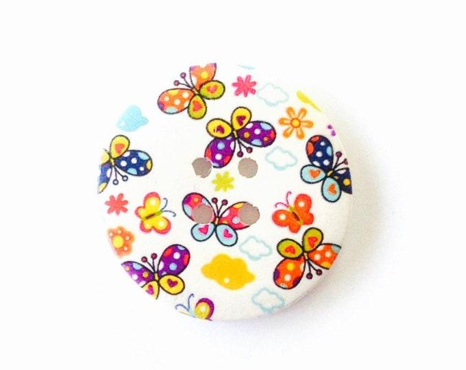 50mm button featuring spotty and heart butterflies