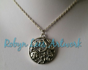 Silver Night & Day Medallion Style Necklace with Smiling Sun, Stars and Crescent Moon on Silver Crossed Chain or Black Faux Suede Cord