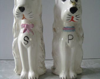 Mid Century dog salt and pepper shaker set. Bees and bows. kitchen collectible shakers hand painted accents.