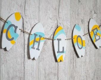 Custom baby name banner Surfboard birthday Baby girl nursery Surf banner Baby shower decor Kids name banner Yellow Blue nursery decor