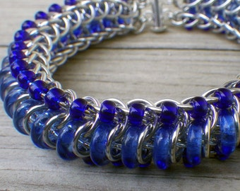 "Blue and silver beaded chainmaille bracelet; chain mail bracelet; chainmaille jewelry; ""glass caterpillar"" bracelet; beaded chain maille"