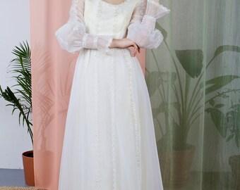 La Constance - 1970s cream wedding dress with green beading
