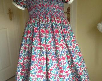 Girls dress. Liberty print Poppy and Daisy, hand smocked, age 5 to 6.