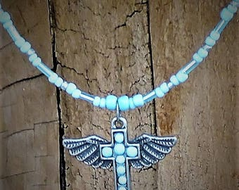 Tiny winged angel necklace