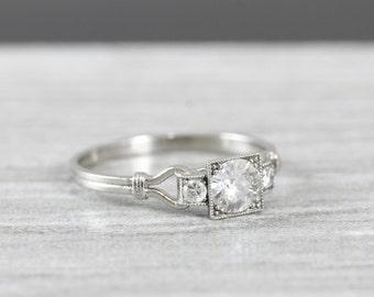 Diamond engagement ring handmade in 14 carat white gold art deco inspired