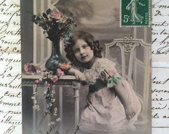 Antique photo of Victorian Little girl  on 900s French postcard