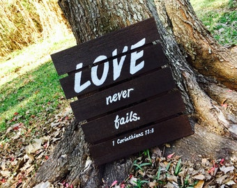 "Wood ""Love never fails"" Sign"