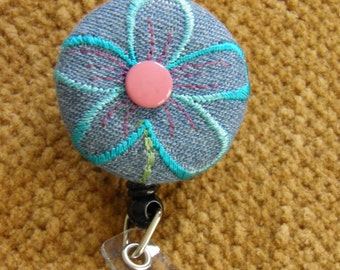 Flower bade reel, ID holder
