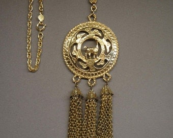 Vintage Egyptian Revival Accessocraft N.Y.C. gold-tone metal 2 inch round pendant necklace w/ trio of 2 inch chain tassels, As New, Stunning