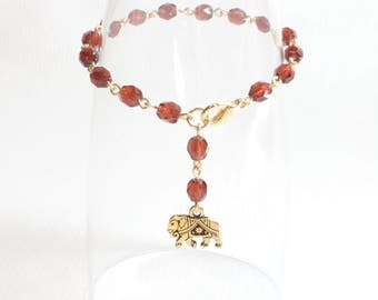 Cranberry Red Crystal Rosary Style Bracelet with Gold Gita Elephant