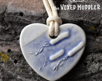 Microbiology clay pendant necklace with adjustable cord, flagellate bacteria in a heart