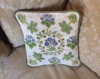 A sweet wool tapestry cushion with beautiful violet and cowslip design.