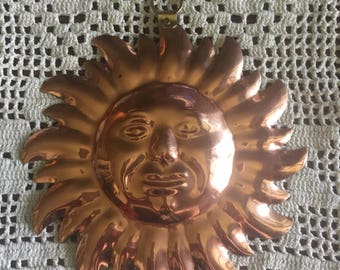 Vintage copper sun wall art