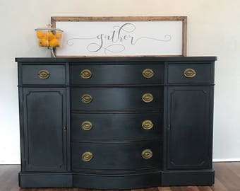 SOLD -if looking for something similar please message me for details..Drexel black bow front buffet/sideboard/tv console/entry way