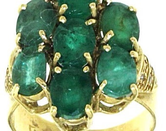 Ring with 18-carat gold diamond 7 Emerald and 12