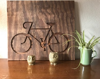 "Bicycle engraved on 16""x16"" plywood stained with dark walnut"