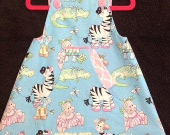 Zebra print girls dress featuring cute kangaroo pocket