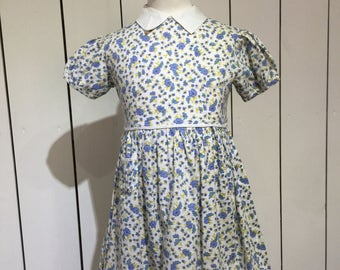 Original 1950's ditsy floral meadow print dress in blues and yellows - Darling little dress with accents of crisp white in the details.