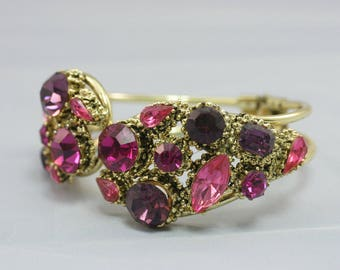 Gold Tone Clamper Bracelet with Pink and Purple Stones