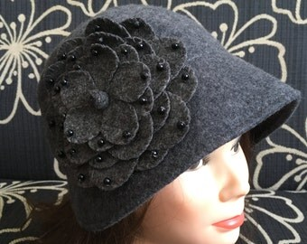 Grey vintage hat with a big flower on the one of side 100% wool made in Italy