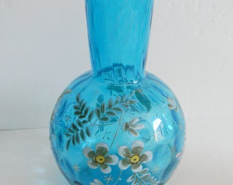 Art glass vase with enamelled flowers and inverted thumbprint