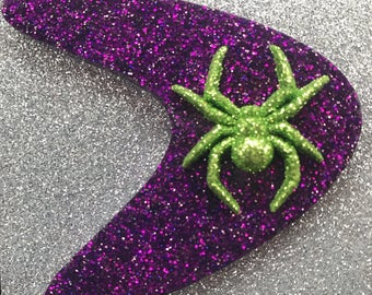 Purple boomerang with green spider glitter resin brooch