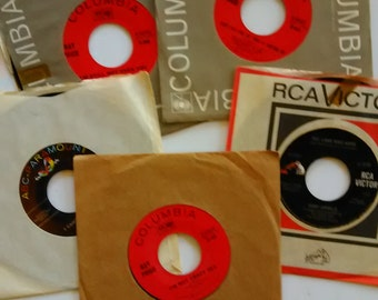 48.   Five (5) vintage 45 records