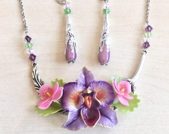 Purple, pink and silver orchid set in cold porcelain and Swarovski crystal