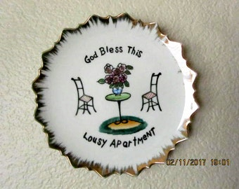 Bradley exclusives Japan, wall plate Bless this Lousy Apartment gold rimmed dish