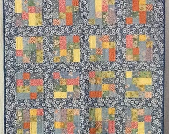 This quilt is made entirely with repro fabrics.  It would have been perfect on my crib in 1935. It is 37X44.5 and would work on the floor.