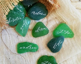 Natural sea glass place cards with romantic, modern calligraphy