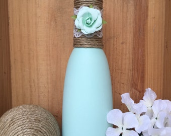Mint green chalk painted bottle with twine, lace, and mint flower