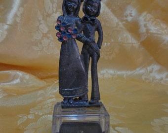 Pair of pewter figurines
