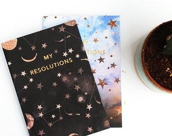 Mon carnet de notes de résolutions nuageux étoiles