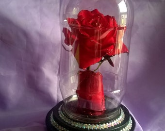 beauty and the beast styled red rose in a cloche,the base lights up when switched on,great table decoration for birthday,wedding or party