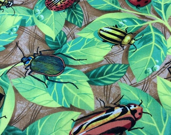 Backyard safari by Jonny karean for Clothworks.Fun print with bugs through out 04286-21