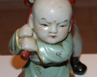 Very Beautiful Chinese Porcelain or Pottery Boys Statue.