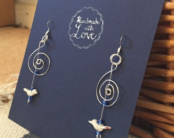 Like a bird on a wire, inspired by Leonard Cohen, Silverwire Treble Clef Earrings with tiny mother of pearl handcarved bird