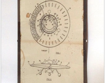 Aged reproduction print of patent plans for a rotating flying disc in frame.