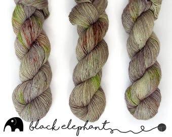 Acheron Hand dyed sock weight yarn  superwash merino contemporary single ply yarn speckled yarn dark violet green brown 100g