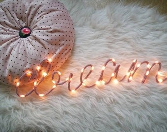 "Knitting word ""dream"" bright night light"