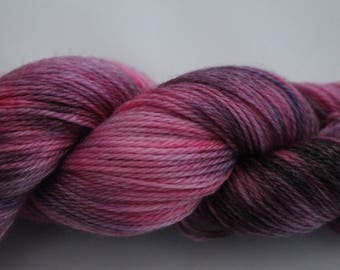A Luxuriously soft Hand dyed 4ply Yarn on a Super Wash Merino, Tencel base in the Spring Garden colourway. A blend of soft Pinks and Purples