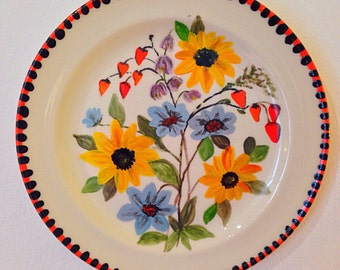 Vintage folk art hand painted ceramic plate with floral motif, bright patterns. Serving plate or hanging plate, wall art. Strawberry pattern
