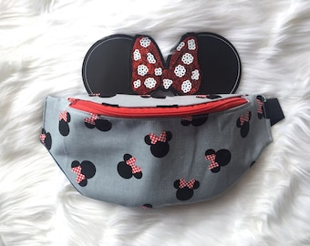 Gray minnie mouse fanny pack with minnie mouse inspired bow and ears attacted.