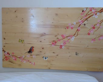 Beautiful headboard with flowers, butterflies and bird/beautiful headboard of bed with butterflies, flowers and bird