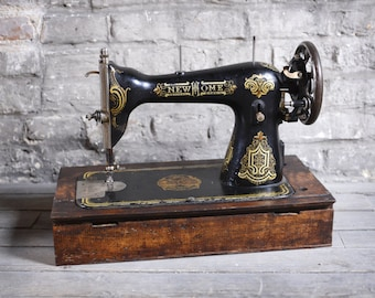 Old sewing machine with wooden base and small cache inside - from France